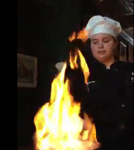Chef working with flaming pan
